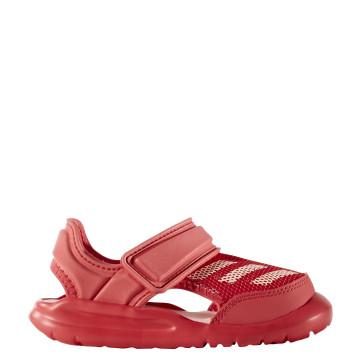 Σανδάλια θαλάσσης Adidas σε κοραλί χρώμα. Κλείνουν με βέλκρο για να προσαρμόζονται απόλυτα στο πόδι. Είναι κλειστά στο μπροστινό μέρος για μεγαλύτερη προστασία των δακτύλων του ποδιού. Φτιαγμένα από ειδικό μαλακό υλικό EVA , το οποίο τα κάνει άνετα και αν